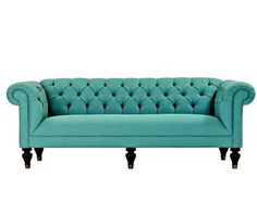turquoise tufted couch - color of the month- tantalizing turquoise (home design and decorating ideas, trends, and inspiration)