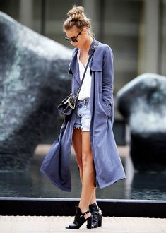 Happily Grey blogger wears a light blue duster coat and cut-out ankle boots