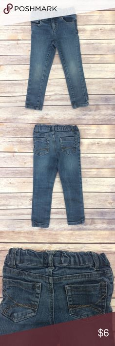Kids R Us Skinny Jeans Blue skinny jeans with an adjustable waist. 5 pockets. Some wear in the knees (no holes), overall, in very good used condition. 19019-203 Kids R Us Bottoms Jeans