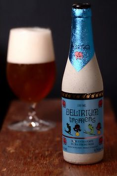 Delirium Tremens (Belgian Strong Ale) -- Pours straw with a white head. Hoppy, fruity aroma. Sour sweet taste, lingering peppery flavour with a hint of citrus.