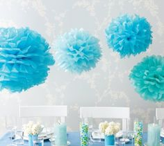 f025489d551 hanging tissue paper pom pom decoration in blue to celebrate baby shower  party