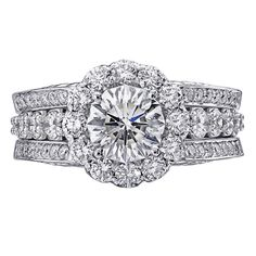 Christopher Designs ring with 2.49ct Crisscut Round center surrounded by 1.69ct round diamonds.
