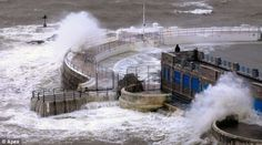 Crashing waves: Stormy seas batter Tinside Lido on the seafront at Plymouth, Devon