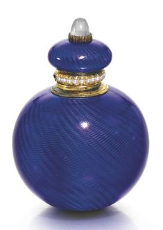 A FABERGÉ GOLD-MOUNTED ENAMEL SCENT BOTTLE, WORKMASTER HENRIK WIGSTRÖM, ST PETERSBURG, 1903-1904    spherical, the surface of translucent royal blue enamel over wavy engine-turning, the cushion-form lid set with a moonstone, the rim mount with seed pearls, struck with workmaster's initials, 56 standard, scratched inventory number 10417  height: 4.7cm, 1 7/8 in.