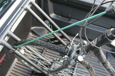 Bike secured in the rack with bungee cord. Armazenamento De Bicicletas caedfe41e3ee