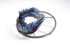 heather woof - windswept brooch 2012 - hand cut titanium and mild steel.