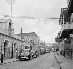 A street view of as cars park along busy street in Charlotte Amalie, St. Thomas, US Virgin Islands.
