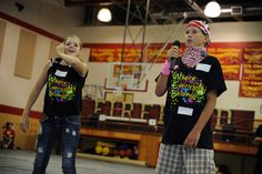 """Eighth graders Emma Stanley, 13, and Bryan Calhoun, 13, lead orientation activities for sixth grade students Aug. 3, during their first day at Falcon Middle School. Approximately 60 eighth grade students are participating as leaders in the school's """"Where Everybody Belongs"""" orientation and transition program. Their goal: help the school's youngest class, more than 300 students, feel comfortable throughout their first middle school experience."""