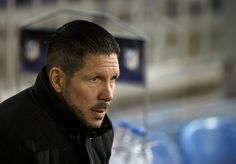 Atletico Madrid's Argentinian coach Diego Simeone looks on before the Spanish Copa del Rey (King's Cup) round of 16 first leg football match Club Atletico de Madrid vs Real Madrid CF at the Vicente Calderon stadium in Madrid on January 7, 2015.