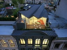 Unseen above the restored cast-iron facade of this 1857 residential structure in Tribeca, a stunning modern loft extends the building's livable space, its form responding directly to lines of…