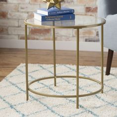 Showcasing a golden finish and sleek glass surface, this lovely Alsager End Table is perfect for anchoring a bold lamp and stack of glossy magazines.