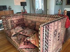 Vintage Kilim Knole with high finials and red tie backs