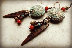 Tribal style earrings designed by Joan Williams. The cool dimpled brass beads are from Plum Bazaar!