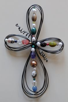 Handmade Beaded Wire Cross 9 x 6. $25.00, via Etsy.
