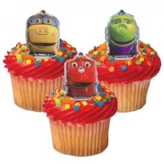 "For the Twins 4th Birthday, they wanted a ""Chuggington Themed"" Party. So I played around with some different frostings..purple and green for KoKo, blue and yellow for Brewster, and of course red for Wilson. All the kids loved the cupcakes, but maybe the Chuggington Cupcake Rings even more!"