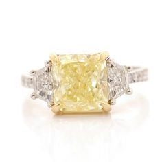 Solitaire & Trapezoid pave Side Stone Ring