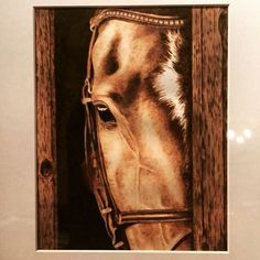 Pyrography of a horse. If you want to see more pyrography by this artist go to her shop on etsy... She takes commissions, and does great work! WoodBurnedBeauty