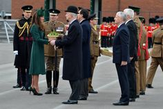 Will & Kate, the Duke & Duchess of Cambridge, attended the St. Patrick's Day parade with the Irish Guards and took part in the annual ceremony of handing out shamrocks to members of the Guards. Kate wore a new green coat from Hobbs called  'Persephone', a green Gina Foster hat, and Emmy 'Valerie' shoes. - 3/17/2014