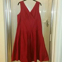 ***SOLD***Red Double V-neck Fit & Flair dress Very cute cotton blend (97% cotton, 3% spandex) dress, side zipper & belt loops so you can tie it in the front or back! Lightly lined with long ties. Marianne  Dresses Midi