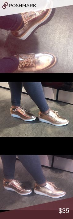 Gold Platform Lace Up Sneakers Super comfy platform sneakers size 10 with tan laces. Super fun with a platform heel and super trendy golden tone. Brand new and perfect for the upcoming spring weather. REASONABLE OFFERS ACCEPTED. 💋 Shoes Sneakers