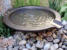 catch basin with spout to divert water to drain