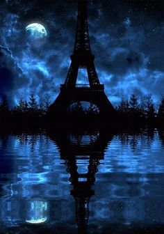 A Cloudy Blue Night with the Eiffel Tower