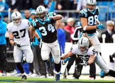 CHARLOTTE, NC - DECEMBER 23: DeAngelo Williams #34 of the Carolina Panthers breaks away from Philip Wheeler #52 of the Oakland Raiders during play at Bank of America Stadium on December 23, 2012 in Charlotte, North Carolina. (Photo by Grant Halverson/Getty Images)