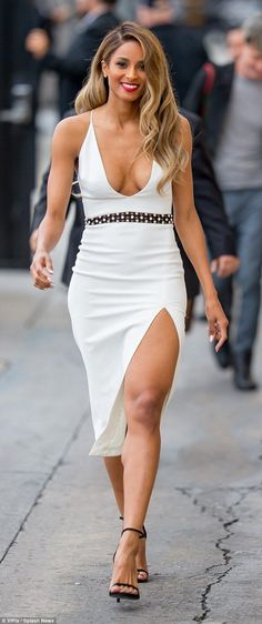 Shapely: The singer and model, 30, showed off her shapely legs in the outfit that had a skirt slit to the thigh and wore black sandal heels