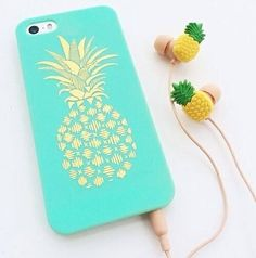 Adorable way to add a little pop of color to your cellphone! Mint pineapple case with gold detail and matching ear phones