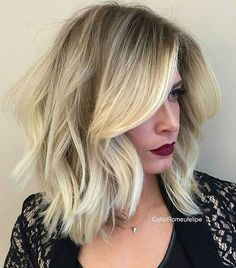 long blonde bob with darkened roots