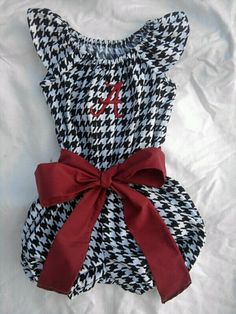 "Roll Tide!! Your little one will be the southern belle of tailgating in this lovely houndstooth romper. The Alabama ""A"" is embroidered on in crimson and to finish the look off, is a beautiful crimson sash.  Sizes 12 month-8 Additional $5 for sizes 10-12. Please  convo me for a special listing.  https://www.etsy.com/listing/158159699/alabama-houndstooth-romper-outfit"