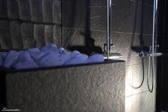 Dark sauna heater by Tulikivi. Read more at http://kaaoksestakodiksi.blogspot.com/2012/04/sauna-on-nyt-lammin.html