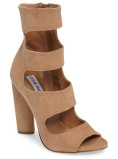 tawnie cage sandal by Steve Madden. Deeply carved cutouts tracing the elongated vamp underscore the on-trend appeal of a caged sandal lofted skyhigh by a...