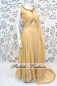 PalkhiFashion Exclusive Full Flair Gold Soft Silk Outfit with Elegant Top Work.