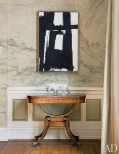 A classic Kline abstraction makes a strong statement paired with a Regency table and a Han-dynasty ceramic bull | archdigest.com