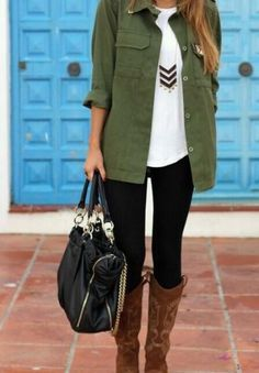 military jacket, white shirt, pendant necklace, black jeans and brown rider boots
