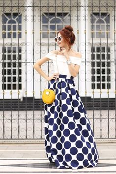 In love with this polka dot skirt from Eliza J in navy and white. Such a classic and cool piece! Also wearing a white top and yellow bag.