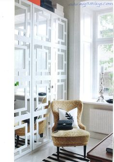 Fretwork can dress up simple pieces like these custom made overlays for mirrored IKEA Pax