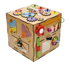 We composed Busy boards into the Busy Box. This Busy Box has pleasure sound source and lit butterfly. The Busy Box contains: - a moving gears puzzle - a sorter - a flashlight - doors with a locks - a zipper - Strap with fasteksy - lacing - a bell - colored scores - lit butterfly - keychain lamp - 7 colors flashing - a button fastener - plesure melody - a maze - two storage tanks to house trifles and toys (drawer and the room behind the door) - numbers (or letters) on the velcro in order to…