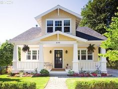white front door yellow house. pale yellowcream body white trim and painted porches dark front door yellow house