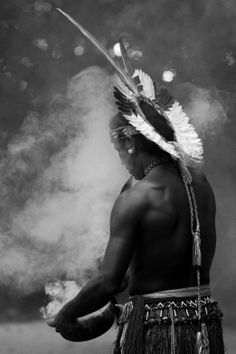 Shaman, Pataxo tribe, Bahia. Deep in the forest the Pataxo tribe is reviving their culture and inviting people to learn about them. Clearing psychic space with sacred smoke.