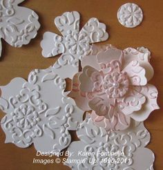 parts to layered paper flowers ... love the embossing on flowers ... Blossoms punch and Floral Framelits die ... Stampin' Up!