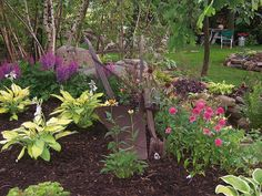 Shade Garden Design Ideas small shade garden astilbes fuchsias hostas creeping jenny Landscape Design Landscapinggardens Shade Garden Hostas Perennials Rock Garden