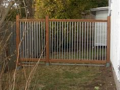 Homemade Dog Fence fence for dogs. Love the vertical bars. Nearly impossible for climbers and jumpers to get out.