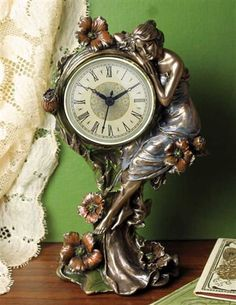 Simply stunning. HOUR'S EMBRACE ART NOUVEAU CLOCK from Victorian Trading Company