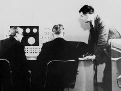 Alan Turing (standing) with colleagues working on Ferranti Mark 1 computer, 1951. Turing worked on the Ferranti when he was based at Manchester University with Dr Max Newman. It was to Newman that the young Turing had first shown his 1937 paper setting out the basis for a universal computer, On Computable Numbers.
