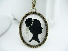 19 x 24. THOSE FRENCH KNOTS! Black silhouette cross stitch necklace.