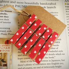 5 small wooden clothes pegs, red with white hearts. £2.50, via Etsy.