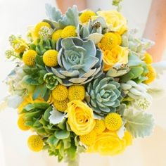 A stunning use of succulents and the color yellow. A custom Vera Wang gown, and canary maxi bridesmaids dresses (image via Boyd Harris)