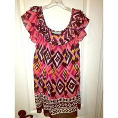 Karlie Ruffle Ikat Dress size Small Dress can be worn off the shoulder or as a scooped neckline. I'm 5'5 and the dress comes right above my knee with flats. Looks great belted or without. Lined with sheer Ikat print overlay. Size Small. Karlie Dresses Mini